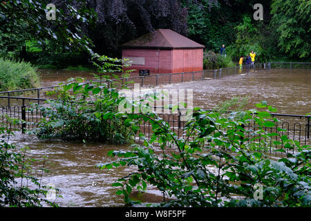 The River Wye in Buxton swollen with floodwater after heavy summer rain - Stock Photo