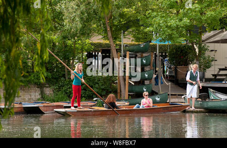 People punting on the River Cam in the city of Cambridge, England. - Stock Photo