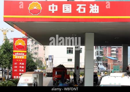 --FILE--Vehicles are being refueled at a gas station of PetroChina, a subsidiary of CNPC (China National Petroleum Corporation), in Beijing, China, 11 - Stock Photo