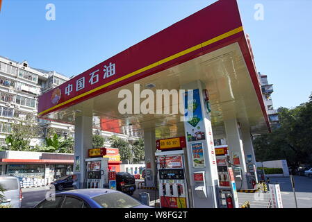 --FILE--Vehicles are being refueled at a gas station of PetroChina, a subsidiary of CNPC (China National Petroleum Corporation), in Fuzhou city, south - Stock Photo