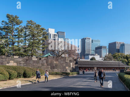 Skyscrapers in the Marunouchi district viewed from the East Gardens of the Imperial Palace, Tokyo, Japan - Stock Photo