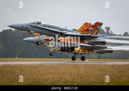 MONT-DE-MARSAN, FRANCE - MAY 17, 2019: Special painted Spanish Air Force Boeing F/A-18 Hornet fighter jet aircraft take off during the NATO Tigermeet - Stock Photo