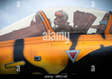 MONT-DE-MARSAN, FRANCE - MAY 17, 2019: Pilot in the cockpit of a special painted Dassault Rafale fighter jet plane taxiing towards the runway at the N - Stock Photo