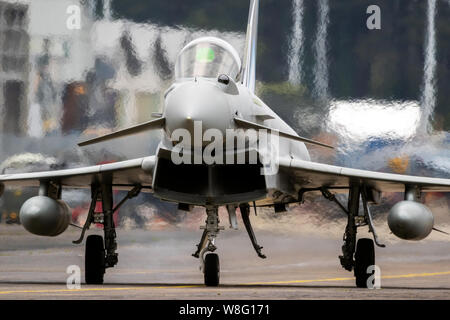 MONT-DE-MARSAN, FRANCE - MAY 17, 2019: Italian Air Force Eurofighter Typhoon F-2000A fighter jet plane taxiing to the runway during the NATO Tigermeet - Stock Photo