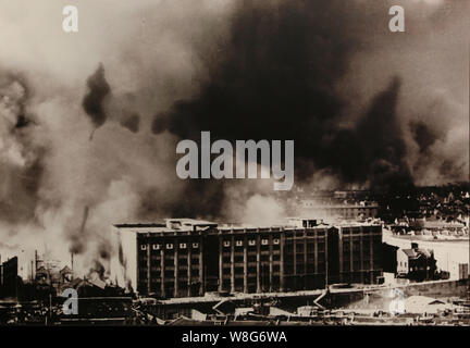 In this picture dated 10 August 2015, a file photo shows dense smoke rising from the Sihang Warehouse while Chinese soldiers were fighting Japanese so - Stock Photo