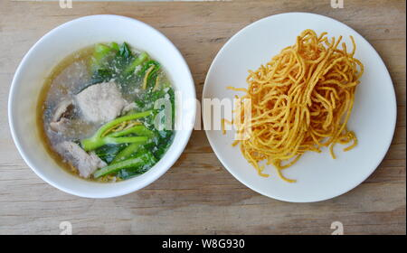 crispy egg noodle with Chinese kale and pork in gravy sauce - Stock Photo