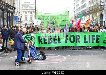 EXTINCTION REBELLION PROTEST BRINGS MUCH OF CENTRAL LONDON TO A HALT. ROAD CLOSURES AS DEPICTED IN THIS PICTURE AT WATERLOO BRIDGE BY A SMALL NUMBER OF PEOPLE HOLDING A REBEL FOR LIFE SIGN. THE TACTIC DESIGNED TO BRING AWARENESS TO HUMAN INDUCED CLIMATE CHANGE. - Stock Photo