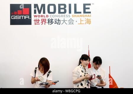 Visitors rest during the GSMA Mobile World Congress 2015 in Shanghai, China, 15 July 2015. Stock Photo
