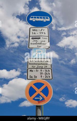 Many traffic signs im Berlin - Stock Photo