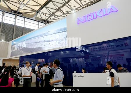 People visit the stand of Nokia during the GSMA Mobile World Congress 2015 in Shanghai, China, 15 July 2015. Stock Photo