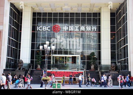 --FILE--Pedestrians walk past a branch of ICBC (Industrial and Commercial Bank of China) in Chongqing, China, 11 October 2015.     The Industrial and - Stock Photo