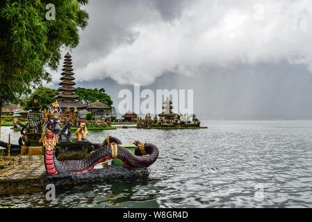 Dragons under the rain in Pura Ulun Danu Beratan territory on Bali island, Indonesia - Stock Photo
