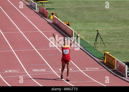 Spain's Miguel Angel Lopez celebrates his victory in the men's 20km Walk during the Beijing 2015 IAAF World Championships in Beijing, China, 23 August - Stock Photo