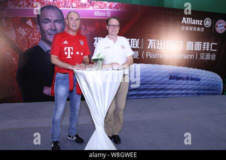 Former German soccer star Raimond Aumann, left, poses during a fan meeting event in Guangzhou city, south China's Guangdong province, 23 July 2015. - Stock Photo