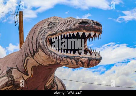 Holbrook, Arizona / USA – August 3, 2919: Brown Dinosaur Statue - Stock Photo