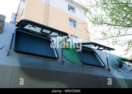 A surveillance camera is seen on the mobile armored camping vehicle parked in front of a military-themed restaurant in Changchun city, northeast China - Stock Photo