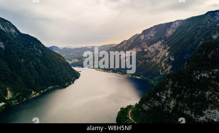 Panoramic aerial view of Famous Hallstatt mountain village, Salzkammergut, Austria in summer day - Stock Photo