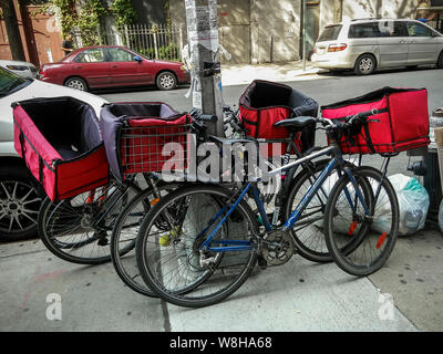 A collection of delivery worker bicycles outside a restaurant in New York on Monday, August 5, 2019. (© Richard B. Levine) - Stock Photo