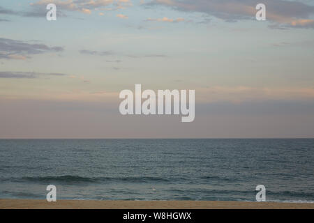 Ocean Beach at Sunset - Stock Photo