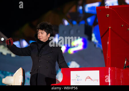 Chinese pianist Lang Lang waves at the 'Countdown to 2015' New Year celebration event in Beijing, China, 31 December 2014. - Stock Photo