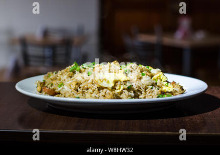 Arroz Chaufa authentic and traditional Peruvian dish - Stock Photo