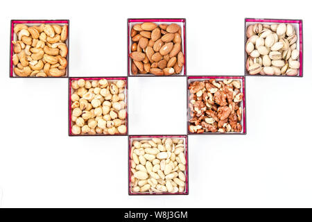 Different types of nuts: peanuts, cashews, almonds, hazelnuts, walnuts and pistachios, horizontal orientation, copy space, top view nuts set - Stock Photo
