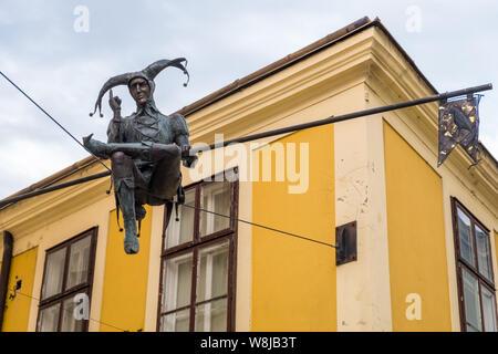 Szekesfehervar, Hungary - July 08, 2019: Monument of Jester sitting on the Rope in the historic center of Szekesfehevar, Hungary - Stock Photo