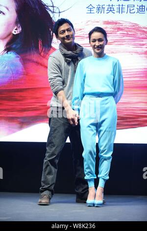 Chinese actress Zhou Xun, front, and her American actor husband Archie Kao pose during a premiere event for the micro film 'Dream Escape' to promote I