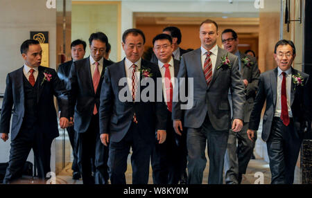 --FILE--Wang Jianlin, front second left, Chairman of Wanda Group, American film producer Thomas Tull, front second right, Chairman and CEO of Legendar - Stock Photo