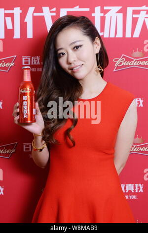 Chinese singer Zhang Liangying poses during a promotional event for Budweiser on the Times Square in New York city, USA, 26 January 2016. - Stock Photo