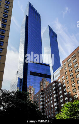Low-angle view of Time Warner Cente by Columbus Circle, Manhattan, New York City, USA. - Stock Photo