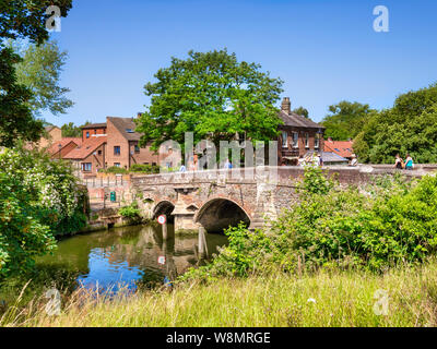 29 June 2019: Norwich, Norfolk, UK - Bishop Bridge, the original of which was built in 1340, spanning the River Wensum, on a fine summer day, clear bl - Stock Photo