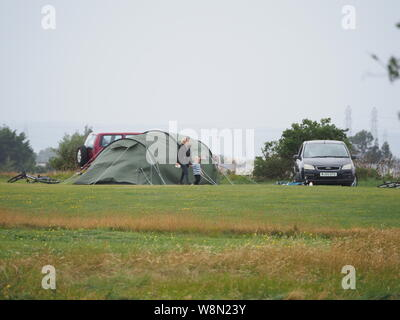 Sheerness, Kent, UK. 10th August, 2019. UK Weather: campers contend with high wind speeds and bad weather in Sheerness, Kent today. Credit: James Bell/Alamy Live News - Stock Photo