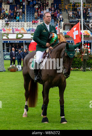 Dublin, Ireland 09 august 2019. Cian O'Connor for Team Ireland compete for the Aga Khan Cup in the Longines Nations Cup Show Jumping at the RDS Dublin Horse Show. Credit: John Rymer/Alamy Live News - Stock Photo