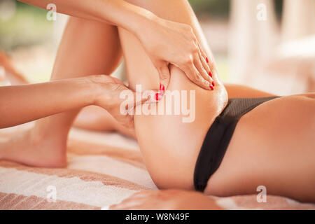 Young Woman Receiving Leg Massage at Spa Center. Body Care - Stock Photo
