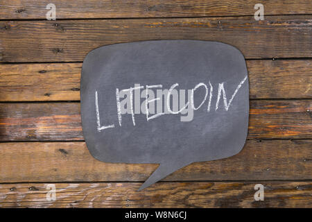 Word, inscription LITECOIN written in chalk on a blackboard made in the form of thought. Top view. - Stock Photo