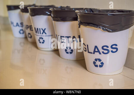 Garbage cans. Trash bins with sorted garbage in kitchen cabinet with segregated household garbage - plastic, paper, metal, glass. Ecology and recycle - Stock Photo