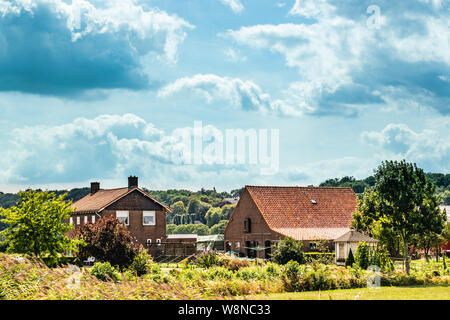A traditional Dutch farm family house in a typical dutch landscape, The photograph was taken in summer in the Ooijpolder - Stock Photo