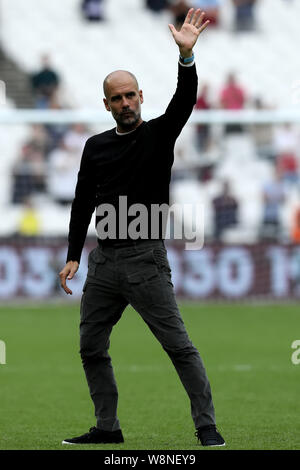 London, UK. 10th August, 2019. London, UK. 10th Aug, 2019.  English Premier League Football, West Ham United versus Manchester City;  Manchester City Manager Josep Guardiola waves to the fans - Strictly Editorial Use Only. No use with unauthorized audio, video, data, fixture lists, club/league logos or 'live' services. Online in-match use limited to 120 images, no video emulation. Credit: Action Plus Sports Images/Alamy Live News - Stock Photo