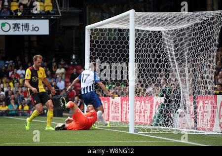 The ball in the back of the net after a cross by Brighton and Hove Albion's Pascal Gross (not in picture) is turned in by Watford's Abdoulaye Doucoure (not in picture) during the Premier League match at Vicarage Road, Watford. - Stock Photo