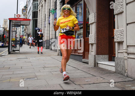 London, UK. 10th Aug, 2019. Participants wearing fancy dress take part in the Great British Beer-a-thon raising for charity by running around a circuit near Fleet Street. Credit: Stephen Chung/Alamy Live News - Stock Photo