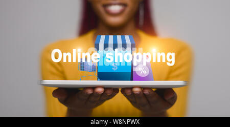 Woman with tablet showing online shopping concept - Stock Photo