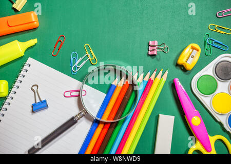 School supplies on chalkboard background, back to school concept. Top view with copy space. - Stock Photo