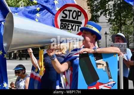Steve Bray ' Mr Shouty Man' used his megaphone to state his opposition to Brexit. SODEM activists protested in favour of the UK remaining in the European Union. The Cabinet Office, Whitehall, London. UK - Stock Photo