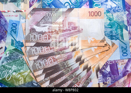 New 2019 Kenyan 1000 Shilling bank notes on other bank notes in various denominations - Stock Photo