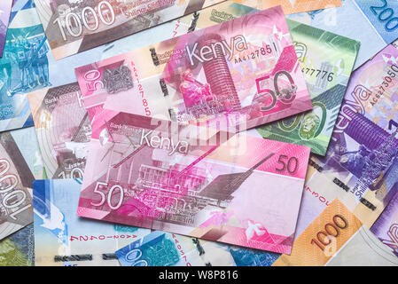 New 2019 Kenyan 50 Shilling bank notes on top of other bank notes in various denominations - Stock Photo