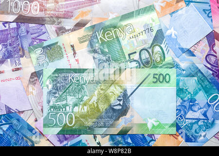 New 2019 Kenyan 500 Shilling bank notes on top of other bank notes in various denominations - Stock Photo