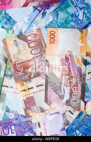 New 2019 Kenyan 1000 Shilling bank notes on top of other bank notes in various denominations - Stock Photo