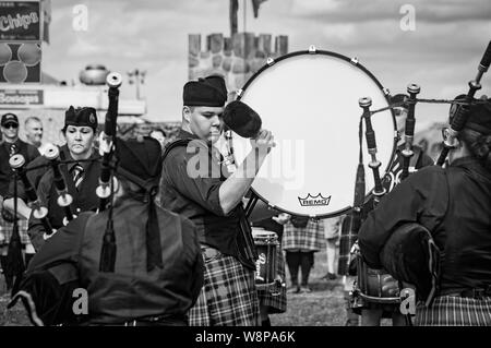 Fergus, Ontario, Canada - 08 11 2018: Drummer of the Hamilton Police Pipes and Drums band participating in the Pipe Band contest held by Pipers and - Stock Photo
