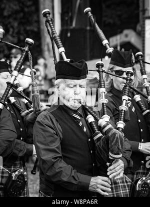 Fergus, Ontario, Canada - 08 11 2018: Piper of the Hamilton Police Pipes and Drums band paricipating in the Pipe Band contest held by Pipers and Pipe - Stock Photo